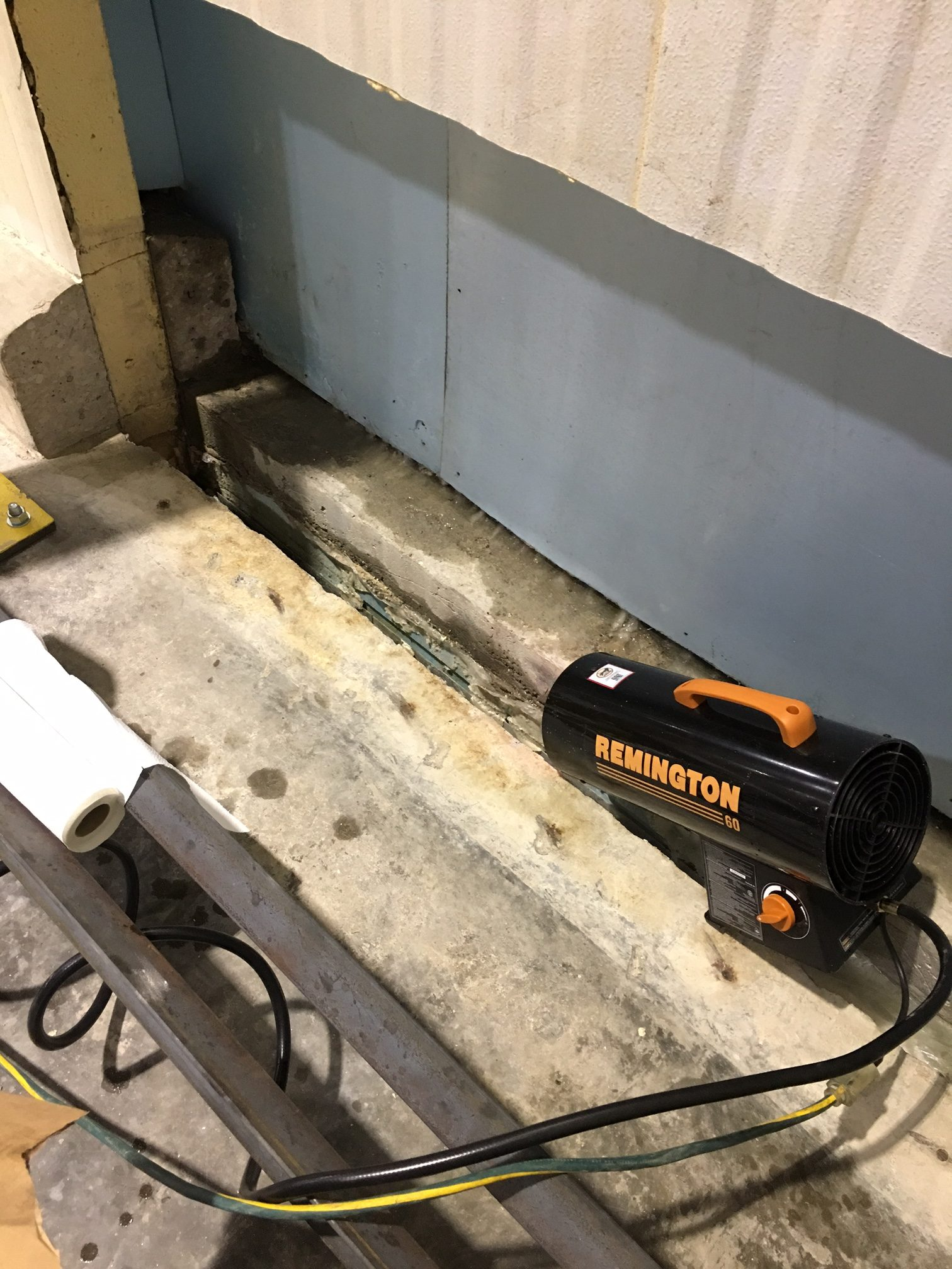 Warm air is applied to drive back the frost and dry the concrete prior to repairing with Roadware 10 Minute Concrete Mender.