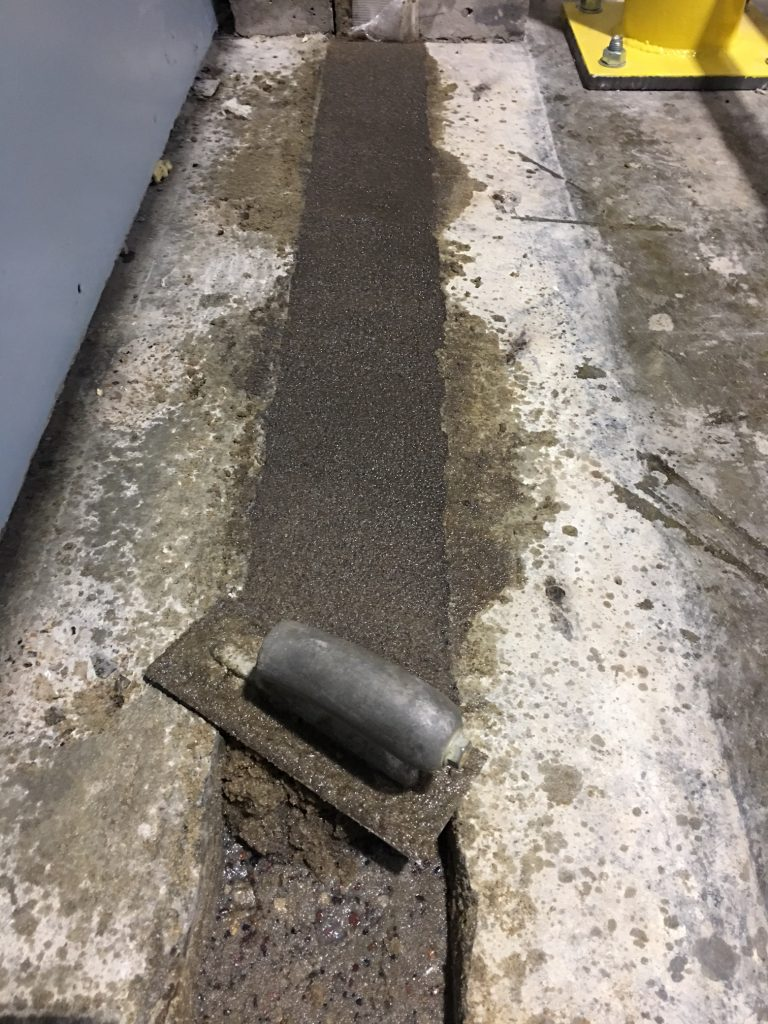 Layers of Roadware 10 Minute Concrete Mender mixed with sand are added up to the finished grade.