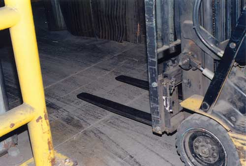 Forklift driving over freezer threshold repaired with Roadware 10 Minute Concrete Mender™.