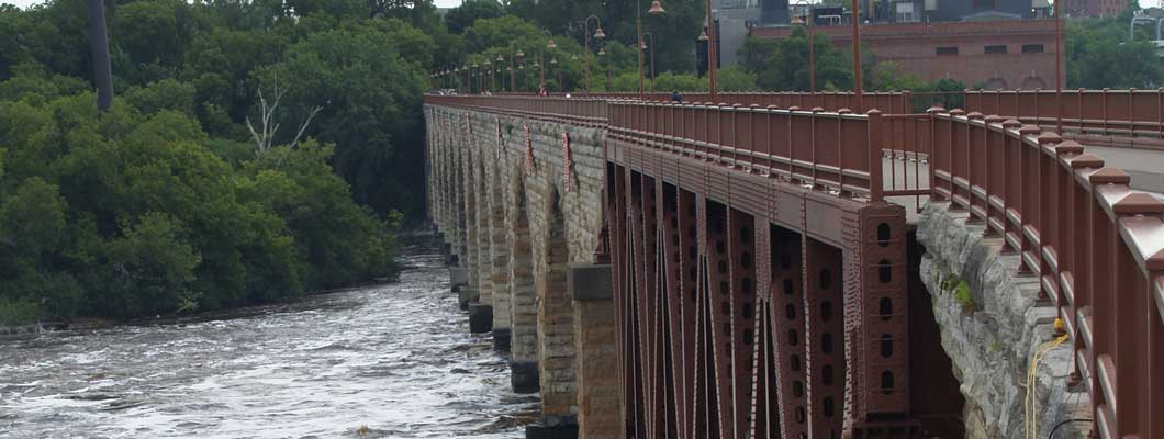 Using Roadware MatchCrete™ Clear to repair cracks on the historic Stone Arch Bridge.