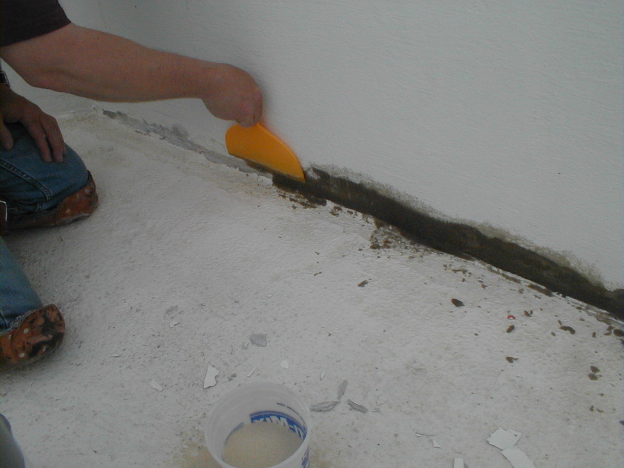 Pool repairs at the pool edge are made with Concrete Mender mixed with sand and troweled in place.