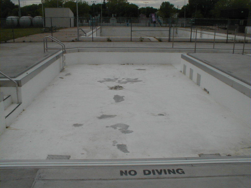 Finished Concrete Mender spall repairs in pool were ready for paint in minutes.
