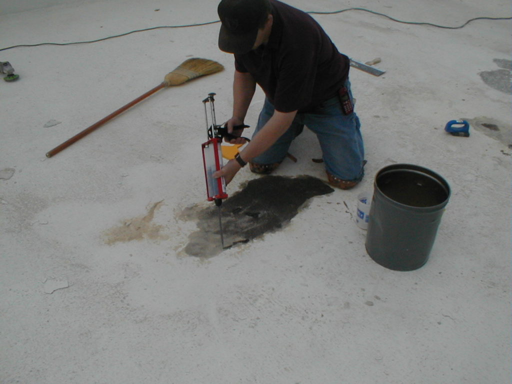 Roadware 10 Minute Concrete Mender and sand are applied to spalls in the pool floor.